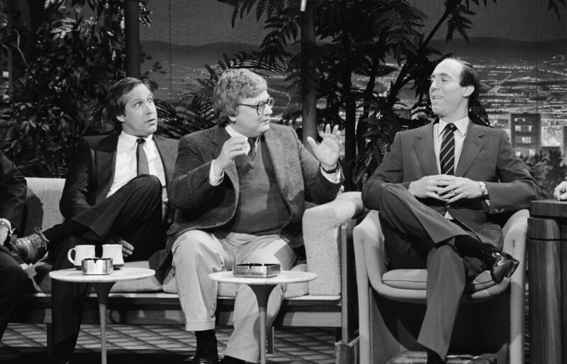 Film critics Roger Ebert (center) and Gene Siskel appear on The Tonight Show with Johnny Carson on December 12, 1986.